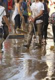 Villagers cleaning after floodings in San Llorenc in the island Mallorca vertical stock image