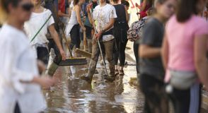 Villagers cleaning after floodings in San Llorenc in the island Mallorca wide royalty free stock photos