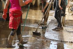 Villagers cleaning after floodings in San Llorenc in the island Mallorca detail stock image