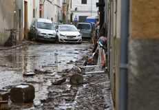 Villagers cleaning after floodings in San Llorenc in the island Mallorca stock photography
