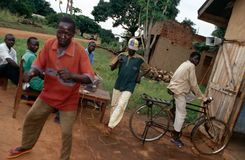 Villagers dancing to music, Uganda Stock Photo