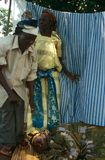 Villagers helping an ill woman in Uganda Royalty Free Stock Image