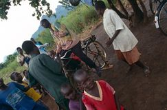 Villagers listening to pedal-powered radio, Uganda Royalty Free Stock Photo