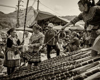 Villagers negotiate price at central open market at Sapa, Vietnam. Vintage feel in black and white of minority tribes doing business on the street in the late royalty free stock photography