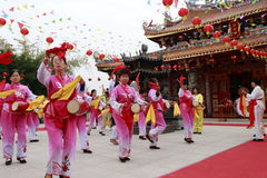 Villagers playing drum to celebrate the completion of taiqing palace Stock Image