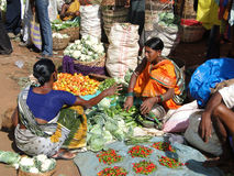 Villagers sell squash, cucumbers  and other vegeta Stock Image