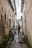Villagers standing in the Narrow Lane Royalty Free Stock Photography