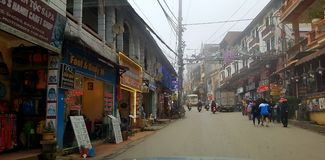 Villagers on streets of Sa Pa, Vietnam. Villagers on streets outside shops in Sa Pa, or Sapa, Vietnam stock photography