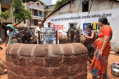 Villagers take water from a traditional public well Stock Photography
