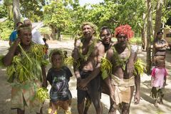 Villagers traditional costumed, nature material, Solomon Islands, South Pacific Ocean. Men, woman and child costumed in natural material in Nemba, Utupua Stock Photography