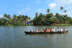 Villagers travel in a traditional boat in the backwaters Stock Photo