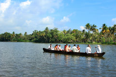 Villagers travel in a traditional boat in the backwaters Stock Images