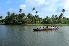 Villagers travel in a traditional boat in the backwaters Royalty Free Stock Images