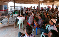 Villagers watching TV in Cambodia royalty free stock photography