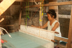 Villagers weaving . Stock Images
