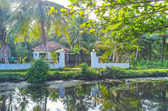 The villages along the Hamilton`s Canal, Sri Lanka. The shady bank of Hamilton`s Canal, that connects Colombo and Negombo and boasts scenic tropic nature Royalty Free Stock Photo