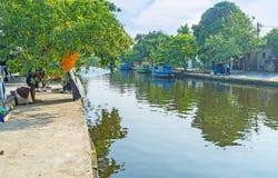 The villages on Hamilton`s Canal, Sri Lanka. The village street along the bank of Hamilton`s Canal between Colombo and Negombo, Wattala suburb, Sri Lanka Royalty Free Stock Images