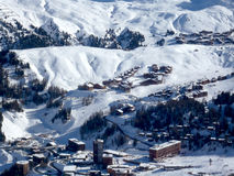 Villages in the snow as seen from a mountain top Royalty Free Stock Image