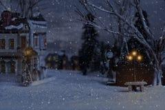 Villaggio di Natale con il banco e la lanterna immagini stock