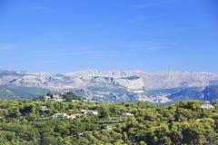 Villaggio di pendio di collina e ville Francia Fotografia Stock