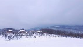 Villaggio il giorno di inverno della neve Fotografia Stock Libera da Diritti