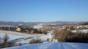 Villaggio il giorno di inverno soleggiato Fotografia Stock