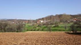 Villaggio il giorno soleggiato Fotografia Stock