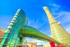Villaggio Mall and Aspire Tower. Doha, Qatar - February 21, 2019: Aspire Tower or The Torch Doha, skyscraper hotel with private walkway access to Villaggio Mall royalty free stock image