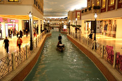 Villaggio Mall in Doha, Qatar. Located in the Aspire Zone. The shopping mall has an Italian theme with a 150-meter long indoor canal with gondolas. Landmark of Stock Image