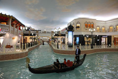Villaggio Mall Shopping in Doha. Canal and Gondola inside of the Villaggio Mall Shopping Center in Doha, Qatar. Photo taken at 7th of January 2012 Royalty Free Stock Photos