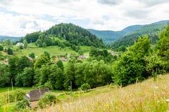 Villaggio nelle montagne Fotografia Stock