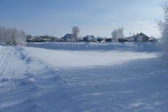 Villaggio sotto neve Immagine Stock