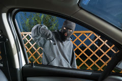Villain with a gun threatened driver Stock Photography
