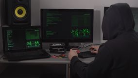 Villain Hacker gains access to bank accounts using a credit card customers and special software on a powerful computer stock video