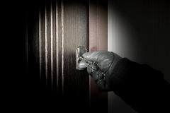 Villain opens the apartment burglary at night Royalty Free Stock Images