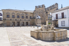 Villalar arc,Jaen gate and Lions fountain, Populo square, Baeza,. Jaen, Spain Stock Photos