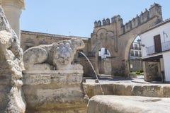 Villalar arc,Jaen gate and Lions fountain, Populo square, Baeza,. Jaen, Spain Royalty Free Stock Photo