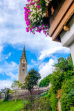 Villandro Villander - Trentino Alto Adige - Sudtirolo - Italy. Bell tower flowers on balcony royalty free stock images