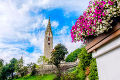 Villandro Villander - Trentino Alto Adige - Sudtirolo - Italy. Colorful summer bell tower flowers on balcony stock photo