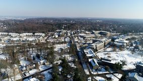 Villanova University Campus aerial from drone looking north bound from Lancaster Avenue in winter time with fresh snow. View of Villanova University Campus stock video footage