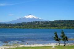 Villarica volcano and lake royalty free stock image