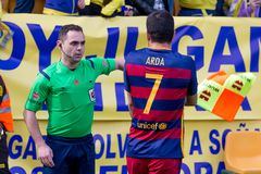 Arda Turan speaks to the referee at the La Liga match between Villarreal CF and FC Barcelona Royalty Free Stock Photography
