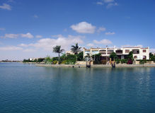 Villas on the beach. Villas and palms on the artificial lake in Marina - Egypt Royalty Free Stock Photography