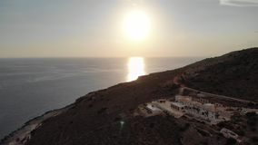 Villas in Greece sunset view. Aerial shot stock footage