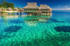 Villas in the lagoon with steps into shallow water with coral Royalty Free Stock Image