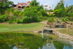 Villas next to golf pond Royalty Free Stock Image