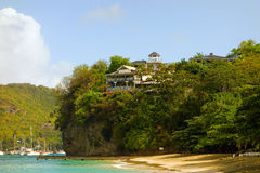 Villas overlooking a pretty beach in the caribbean Stock Photos