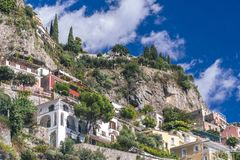 Villas in Positano close up, town at Tyrrhenian sea, Amalfi coast, Italy, hotel and hostel concept, sea with ships and boats, stock photo
