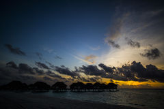 Villas at sunset, Maldives Royalty Free Stock Photo