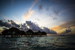 Villas at sunset, Maldives Royalty Free Stock Image